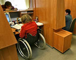 1 15 92219753-FD53 1. инвалидностью, floor, indoor, furniture, desk, table, chair, wheelchair. A group of people in a room