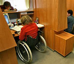 1 21 92219753-FD53 2. инвалидов, indoor, floor, desk, furniture, table, computer, chair. A group of people in a room