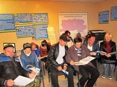 В області триває місячник сприяння зайнятості інвалідів. інвалідністю, person, clothing, indoor, group, ceiling, man, footwear, people, computer, conference room. A group of people in a room