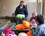 Сприяємо зайнятості громадян з інвалідністю. центру зайнятості, indoor, clothing, person, toddler, smile, baby, toy, human face. A group of people performing on a counter