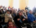 У Слов'янську відбулось перше засідання Консультативної ради Донецької ОДА з питань людей з інвалідністю (ФОТО, ВІДЕО). інвалідністю, person, human face, clothing, indoor, woman, group, man, smile, people, girl. A group of people sitting in front of a crowd