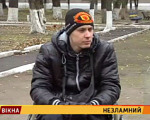 Незламний (ВІДЕО). руслан борисов, outdoor, jacket, person, clothing, human face, man. A person holding a sign