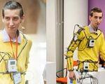 22-річний українець переміг на конкурсі робототехніки у США (ВІДЕО). антон головаченко, person, indoor, clothing, standing, automaton, yellow, smile, human face, doll, work-clothing. A couple of people that are standing in a room