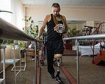 Кабмін скоротив використання протезів для інвалідів АТО з 4,5 до 3 років. протезів, інвалідністю, floor, indoor, person, sports equipment, footwear, bicycle, physical fitness, clothing, bicycle wheel. A person standing in a room