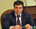 Геннадій Зубко: Державні інвестиції будуть працювати на усі соціальні групи громадян України. геннадій зубко, дфрр, особливими потребами, інвалід, інвестиційний проект, person, suit, wall, indoor, tie, man, human face, clothing. Hennadiy Zubko in a suit and tie