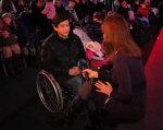 Діти з інвалідністю, але не сироти: чому їм важче, ніж безбатченкам (ВІДЕО). дніпро, держдопомога, дитина-інвалід, обмежені можливості, свято, інвалідність, person, clothing, people, group, woman, crowd. A group of people sitting in front of a crowd