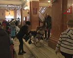 Відвідуєте драмтеатр без перешкод? Як потрапляли на виставу діти на візочках? (ВІДЕО). чернігів, доступ, діти на візочках, особливими потребами, пандус, person, floor, indoor, clothing, people, group, bicycle, wheel, land vehicle, man. A group of people standing in front of a store