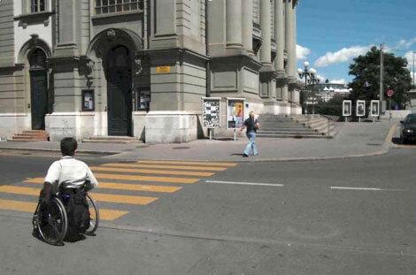 Калушани просять владу облаштувати тротуари та пішохідні доріжки для інвалідів. калуш, обмеженими можливостями, петиция, тротуар, інвалід, road, outdoor, building, bicycle, land vehicle, vehicle, street, wheel, bicycle wheel, people. A person riding a motorcycle on a city street