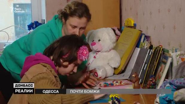 Майже безхатченки: історія переселенців з інвалідністю (ВІДЕО). одеська область, переселенці, притулок, школа-інтернат, інвалідність, indoor, wall, baby, dog, toddler, stuffed, toy, animal, carnivore, teddy bear. A girl holding a teddy bear sitting on top of a stuffed toy
