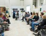 Знайти роботу може кожен: про мотиваційний вечір «Люди з НЕобмеженими можливостями» (ФОТО). київ, мотиваційний вечір, працевлаштування, професійна реалізація, інвалідність, person, indoor, sitting, clothing, footwear, wheelchair, people, group, chair, furniture. A group of people sitting in a room