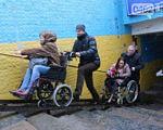 Депутаты и чиновники будут искать в Чернигове места, недоступные для инвалидов. чернигов, доступность, инвалид, инвалидность, рабочая группа, outdoor, person, clothing, footwear, wheel, wheelchair, transport. A group of people riding on the back of a motorcycle