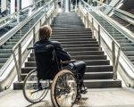 В Сумах будут искать пандусы. сумы, доступность, инвалидность, колясочник, пандус, outdoor, person, building, bicycle, wheelchair, railing, bicycle wheel, wheel, stair, handcart. A person sitting on a bench near a bridge