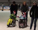 Отець Анджей вигадав… ковзани для колясочників. польща, ковзани, колясочник, о. анджей новак, інвалідна коляска, person, wheelchair, people. A group of people standing around a motorcycle