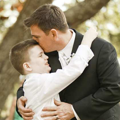 Діти з аутизмом мають шанс на повноцінну освіту і роботу, — Павлюченко. київ, ольга павлюченко, аутизм, вади розвитку, школа-інтернат, person, kiss, outdoor, bride, wedding dress, wedding, love, romance, suit, interaction. A group of people around each other