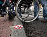 У Кропивницькому моніторять порушення прав людей з інвалідністю. кропивницький, дискримінація, опитування, порушення прав, інвалідність, ground, outdoor, wheel, person, tire, bicycle, bicycle wheel, land vehicle, bike, vehicle. A person standing next to a bicycle