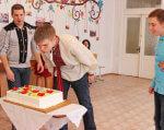 У Кропивницькому Центр соціальної реабілітації дітей відсвяткував ювілей (ФОТО). кропивницький, дітей-інвалідів, центр соціальної реабілітації, ювілей, інвалідність, person, indoor, birthday cake, floor, child, food, boy, cake, clothing, birthday. A little boy standing in front of a birthday cake