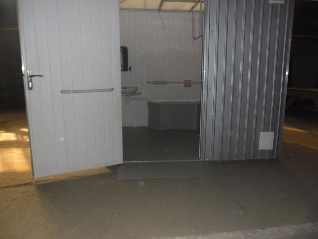 В Мариуполе установят биотуалеты для людей с инвалидностью (ФОТО). мариуполь, биотуалет, доступность, инвалид, инвалидность, floor, door, indoor, building, bathroom, remodel, house, flooring. A door to a building