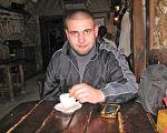 """Айдаровец"" Василий Пелиш: ""Я выпросил себе вторую, рабочую, группу инвалидности. А вдруг рука отрастет?"". василий пелиш, айдаровец, инвалид, инвалидность, протез, person, man, food, clothing, fast food, indoor, human face, meal, dining table. A man sitting at a table with a plate of food"