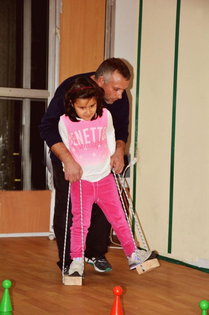 От простого к сложному: какие результаты дает 3С-терапия. 3с-терапия, лихолет илья, аутизм, реабілітація, тренер, floor, person, indoor, clothing, toddler, trousers, human face, footwear, child. A little girl standing in a room