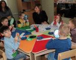 Діти з особливими потребами мають навчатися нарівні з однолітками. виноградівщина, дцп, аутист, навчально-реабілітаційний центр, інвалідність, person, child, indoor, toddler, table, sitting, clothing, baby, group, child art. A group of people sitting at a table