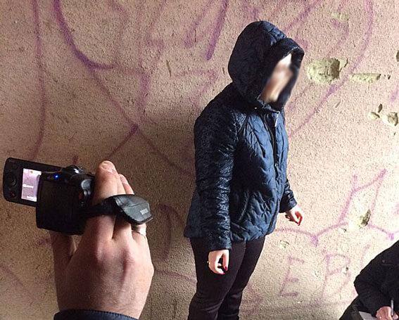 """У Чернівцях поліція затримала """"дует"""" хабарників, які вимагали 650 доларів США від учасника АТО (ФОТО). чернівці, неправомірна вигода, учасник ато, хабарники, інвалідність, person, fashion accessory, clothing, outdoor, watch. A man talking on a cell phone"""