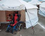 В Женеве начала работу 17-я сессия Комитета ООН по правам инвалидов. женева, комитет оон, инвалид, инвалидность, особыми потребностями, umbrella, tent. A group of people in a tent