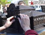 У Черкасах відкрили міні-моделі архітектурних пам'яток міста (ВІДЕО). черкаси, архітектурна пам'ятка, вади зору, міні-модель, обмеженими можливостями, person, outdoor, watch, weapon, gun. A man talking on a cell phone