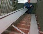 У 70 житлових будинках Харкова встановлять з'їзди для інвалідів-візочників. харків, доступність, обмеженими можливостями, пандус, інвалід-візочник, stairs, ramp, stair, railing, porch, step. A man sitting on top of a wooden fence