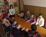 У Чернігові для дітей з особливими потребами відкрита група денного перебування (ВІДЕО). чернігів, група денного перебування, особливими потребами, соціальна адаптація, інвалідність, person, indoor, clothing, human face, wall, toddler, child, girl, group, boy. A group of people sitting at a table
