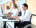 Херсонська обласна служба зайнятості: 324 особи з інвалідністю отримали безкоштовні послуги. херсон, працевлаштування, центр зайнятості, інвалід, інвалідність, person, computer, indoor, laptop, clothing. A man and a woman sitting at a desk with a laptop