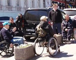 Екскурсійний маршрут: люди з особливими потребами (ВІДЕО). одеса, екскурсійний маршрут, особливими потребами, презентація, інвалідність, road, outdoor, land vehicle, wheel, riding, street, person, vehicle, wheelchair, bicycle. A person riding a motorcycle on a city street