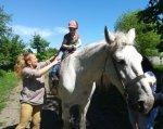 У «Школі життя» лікують дітей верховою їздою (ФОТО). хмельницький, дитина-інвалід, обмеженими фізичними можливостями, центр соціальної реабілітації, іпотерапія, sky, outdoor, tree, person, horse, animal, mammal, standing, clothing, halter. A young man riding a horse