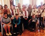 Інклюзія у соціально-культурному просторі. хмельниччина, виставка, круглий стіл, інвалідність, інклюзія, person, posing, indoor, clothing, wheelchair, floor, group, smile, woman, people. A group of people posing for a photo