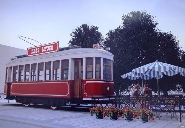 Трамвай+кафе+музей: вінничани з інвалідністю створюють нову атракцію у Вінниці. вінниця, особливими потребами, проект, трамвай-музей-кав'ярня, інвалідність, sky, outdoor, tree, train, vehicle, land vehicle, bus, tram. A red train on the tracks