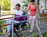 В Николаеве многоэтажки начали оборудовать пандусами, изготовленными инвалидами АТО (ФОТО, ВИДЕО). николаев, ограниченными физическими возможностями, пандус, пилотный проект, інвалід ато, outdoor, tree, person, bicycle, clothing, bicycle wheel, wheel, vehicle, land vehicle. A person sitting on a bench next to a fence