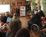 Відкриття центру бібліотечного обслуговування інвалідів (ВІДЕО). кривий ріг, центр інклюзивного бібліотечного обслуговування, бібліотека, особливими потребами, інвалід, person, indoor, clothing, wheelchair, people, group, man, crowd. A group of people in a room