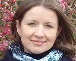 Коли мами стають правозахисницями. психологічна консультація, реабілітаційний центр родина, інвалідність, інклюзія, інтеграція, person, flower, outdoor, human face, smile, clothing, fashion accessory, girl, face, scarf. A woman smiling for the camera