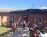 У Городку відкрили відділення соціальної реабілітації дітей-інвалідів. городок, відділення соціальної реабілітації, дитина-інвалід, навички, навчання, outdoor, sky, building, person, house, people, crowd. A group of people standing in front of a building
