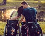 Як двоє закарпатців поїхали на заробітки на інвалідних візках. заробітки, пандус, пенсія, подружжя, інвалідний візок, grass, outdoor, person, wheelchair, chair, seat, bicycle. A person sitting on a bicycle