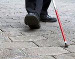 Історія незрячого пенсіонера: перший – і вдалий крок до безоплатної допомоги. безоплатна правова допомога, незрячий, пенсіонер, інвалід, інвалідність, ground, outdoor, footwear, jeans, trousers, person, street, boot, clothing, shoe. A person standing on a sidewalk