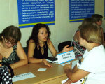 Служба зайнятості – громадянам з інвалідністю. кропивницький, працевлаштування, центр зайнятості, ярмарок вакансій, інвалідність, person, indoor, human face, clothing, people, book, handwriting, classroom, woman. A group of people sitting at a table