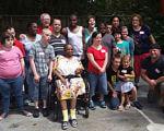 За 40 років пара всиновила і виховала 88 дітей з інвалідністю. всиновлення, дитина, опіка, особливими потребами, інвалідність, person, clothing, smile, footwear, outdoor, group, posing, boy, human face, girl. A group of people standing in front of a crowd posing for the camera