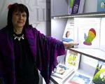 Не всі діти зможуть включитись в інклюзію, — Валентина Бутенко. обмеженими можливостями, спецзаклад, інвалідність, інклюзивна освіта, інклюзія, person, indoor, clothing, child art, smile, human face, purple. A person standing in front of a store