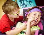 Інвалідність — таке саме життя. Просто інший ритм. олеся яскевич, волонтер, діагноз, табір space camp, інвалідність, person, indoor, toddler, human face, child, little, clothing, girl, boy, baby. A little girl holding a baby