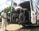 Майже 25 000 $ на благодійність: безкоштовна соляна печера та ще одне соціальне таксі (ВІДЕО). хмельницький, візочник, соляна кімната, соціальне таксі, інвалідність, outdoor, sky, land vehicle, wheel, vehicle, auto part, person, tire, car. A man riding on the back of a truck
