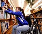 З початку року понад 20 мешканців Кіровоградщини з інвалідністю здобули нові професії. кіровоградщина, професія, підприємство, центр зайнятості, інвалідність, person, book, indoor, shelf, clothing. A young girl sitting in front of a book shelf
