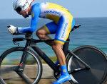 Єгор Дементьєв став другим на чемпіонаті світу з велоспорту. єгор дементьєв, велоспорт, паралімпиєць, чемпіонат світу, інвалід, water, outdoor, sports equipment, bicycle wheel, sky, bike, bicycle, land vehicle, vehicle, wheel. A person riding a bicycle next to a body of water