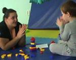 Во Львове расскажут, как установить контакт и коммуникацию в терапии ребенка с аутизмом. львов, аутизм, коммуникация, контакт, тренинг, indoor, person, sitting, toddler, indoor games and sports, games, play, toy, baby, child. A person sitting in front of a laptop