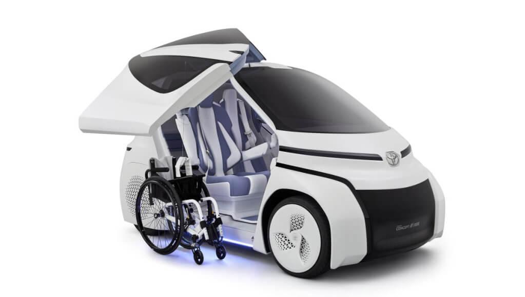 Toyota построила электрокар для людей в инвалидной коляске (ФОТО). toyota concept-i ride, автомобіль, автосалон, инвалидная коляска, электрокар, wheel, land vehicle, vehicle, auto part, tire, car. A close up of a motorcycle