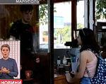 Ветеран з Маріуполя, що отримав інвалідність, відкрив свою міні-кав'ярню (ВІДЕО). мариуполь, ветеран, мотивація, міні-кав'ярня, інвалідність, person, window, clothing, indoor, woman, posing, restaurant. A woman sitting at a table in front of a window